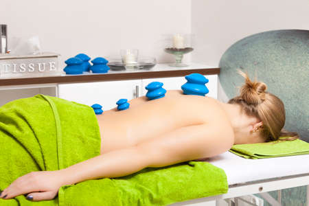 Beauty treatment concept. Woman getting spa therapy cupping glass vacuum massage in salon. Alternative medicine procedure, body care healthy lifestyle. photo