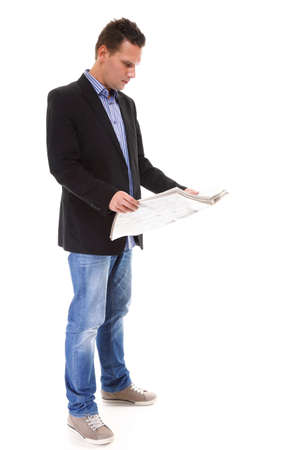 Businessman reading a newspaper full length isolated on white background photo