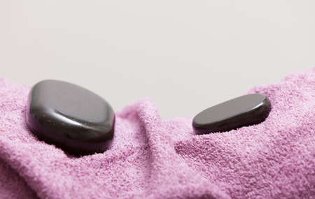spa relax: Spa relax body care concept. Zen, hot massage stone pebbles on pink towel. Healthy lifestyle.