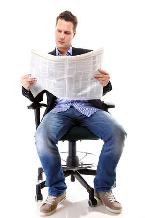 reading a newspaper: Full length businessman sitting on chair reading a newspaper isolated on white background Stock Photo