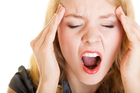 Business woman with head pain screaming. Frustrated blonde girl with headache shouting. Stress in work. Isolated on white. Studio shot. photo