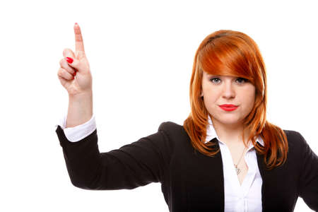 Businesswoman pressing button or something, pointing at the screen. White background
