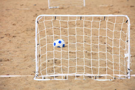 football gate and ball, beach soccer goal photo