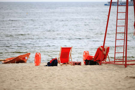 buoyancy: Beach life-saving. Lifeguard on duty rescue equipment orange preserver tool boat, buoyancy aid