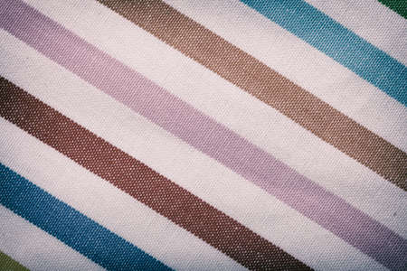 Closeup of colorful diagonal striped fabric textile as texture or pattern. Macro. photo