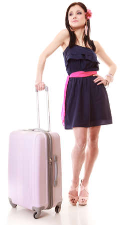 Full length of young summer fashion woman with pink suitcase luggage bag looking at wrist watch isolated on white background. Travel vacation concept. photo