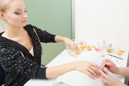 Beautician and of female client   Manicure and skincare   Woman in beauty spa salon photo