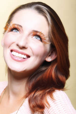 eye lashes: Autumn woman fashion female stylish creative make up false long brown eye lashes autumnal colour  Close up portrait