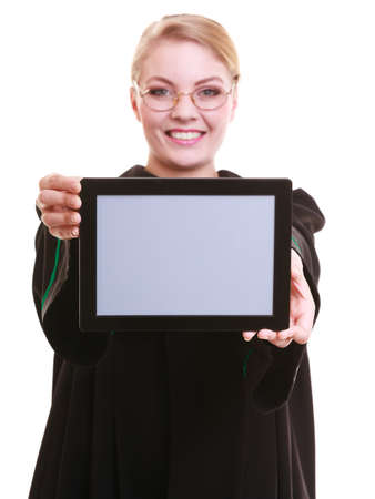 Woman lawyer attorney in classic polish gown holds tablet blank copy space. Technology. photo
