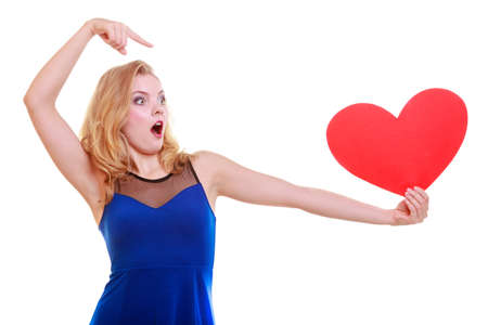 Surprised woman hold Valentine day symbol pointing photo