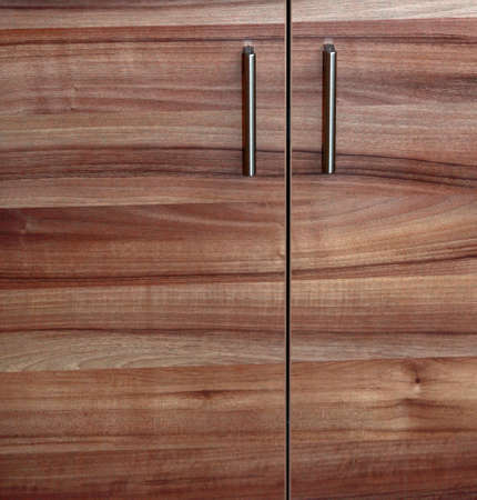 Close-up cupboard wood door, cabinet in kitchen