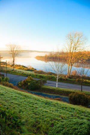 beautiful autumn landscape morning fog over the river  Co.Cork, Ireland Europe photo