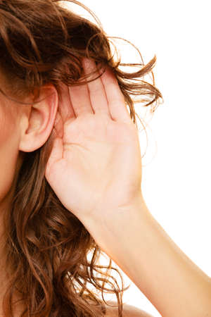blab: Part of head woman female hand to ear listening isolated on white background. Gossip