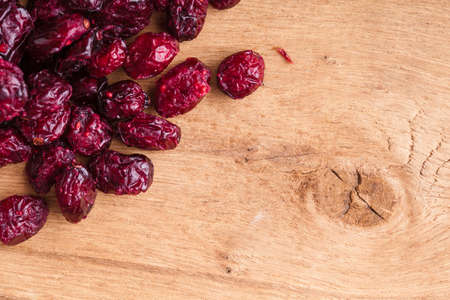 cranberry fruit: Healthy food organic nutrition  Border frame of dried cranberries cranberry fruit on wooden background