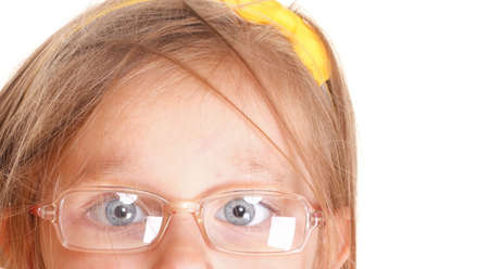 Sight defects poor eyesight in childhood. Little girl part of face wearing glasses isolated on white photo