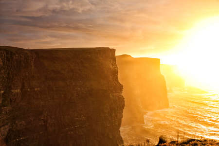 Famous cliffs of Moher at sunset in Co. Clare Ireland natural attraction photo