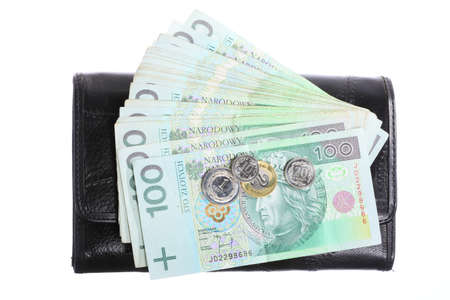 change purse: Economy and finance  Female black purse with money paper currency polish zloty banknote isolated on white background
