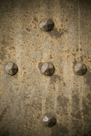 Brown grunge metal plate or armour texture with rivets  photo