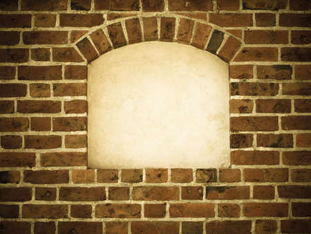 Old stone arch arc niche with space for text frame in brick wall  photo