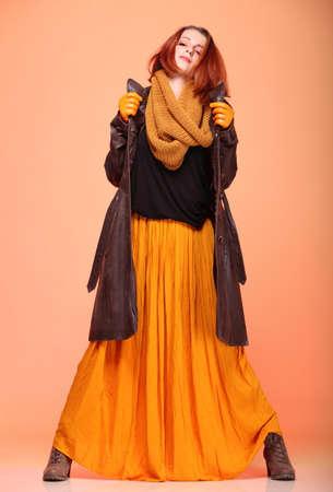 fresh girl: Fall. Fashion woman in autumn color fresh girl in full length long false orange eye-lashes