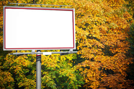Blank white billboard at the park with space for your advertisement photo