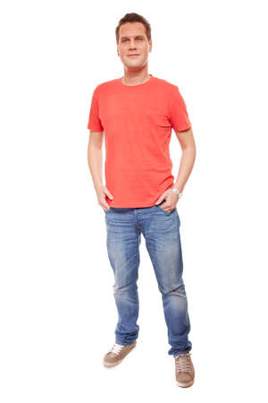 casual fashion: Full length young man wearing red t-shirt jeans casual fashion style with hands in pockets, isolated on white  Stock Photo