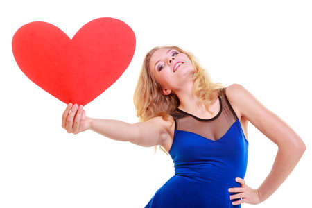 Red heart card  Love symbol  Portrait beautiful woman hold Valentine day symbol  Cute blonde girl in blue dress expressing tender feelings  Isolated studio shot photo