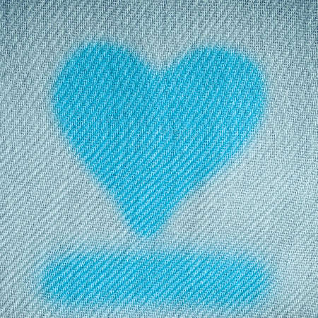 Valentines day background. Heart shape design love symbol on blue canvas textile photo