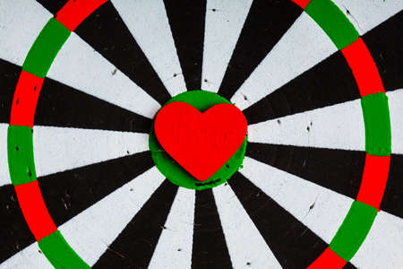 Closeup of old black and white target with red heart symbol bulls eye as love Valentines day  photo