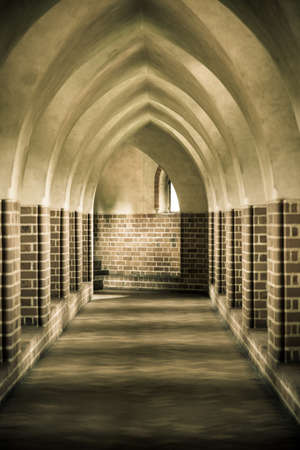 Architectural detail  Interior of old empty hall  Arch of medieval castle or monastery  Sepia tone  photo