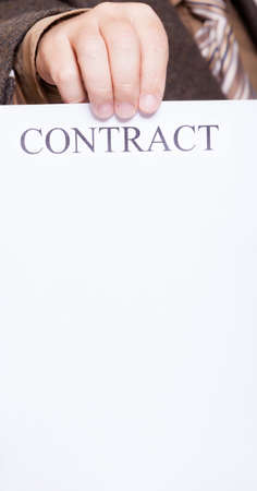 concluding: Business concept. Businessman holding blank empty paper sheet with sign contract and space for text.