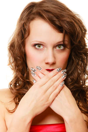 Speak no evil concept. Surprised scared woman face, girl covering her mouth with hands over white background photo