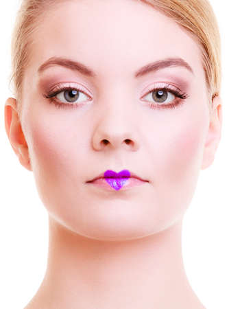 Valentines Day. Portrait of beautiful blond girl young woman with violet heart love symbol on her lips. Creative makeup. Isolated. Studio shot. photo