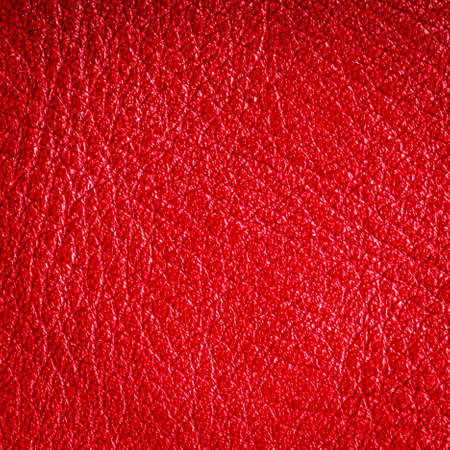 Red leather texture closeup grunge background. Country western background, cowboy rawhide design, abstract pattern. Square format photo