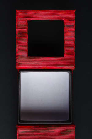 Red black rectangular ring jewellery box on dark background photo