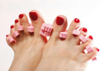 naildesign: foot pedicure applying woman