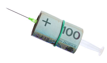 paid medicine: medical treatment and high cost for a good health care service concept  syringe and money polish zloty roll of paper banknotes isolated