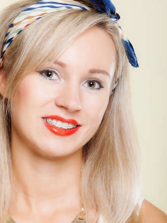straighten: Portrait of blonde fashionable woman happy smiling girl with dental braces - teeth straighten tooth hygiene, dentistry clinic healthy lifestyle.
