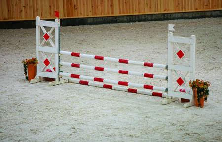 equitation: Equitation  Red white obstacle for jumping horses  Riding competition  Real  Stock Photo