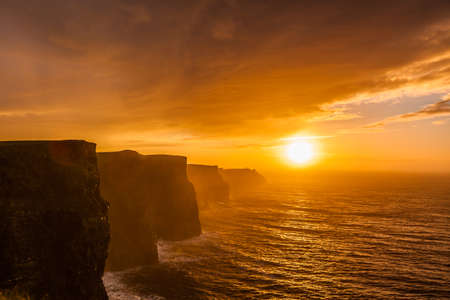 Famous cliffs of Moher at sunset in Co. Clare Ireland Europe. Beautiful landscape natural attraction. photo