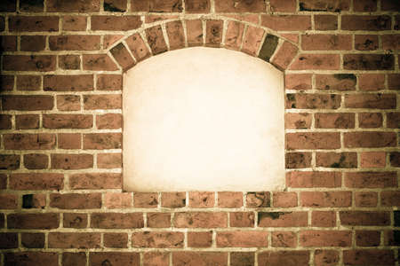 Old stone arch arc niche with space for text frame in brick wall background Stock Photo - 25612153