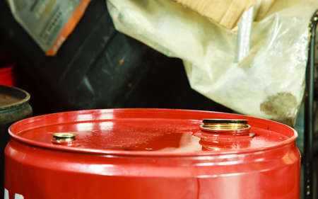 petrolium: Car servicing  oil change  Red oil barrel canister in mechanic garage auto service or shop  Industry detail  Stock Photo