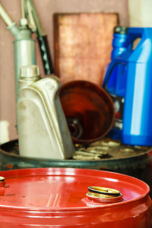 Car servicing  oil change  Red oil barrel canister in mechanic garage auto service or shop  Industry detail  photo