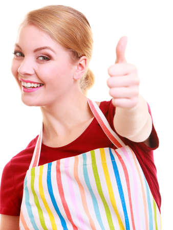 Happy housewife in kitchen apron or small business owner entrepreneur barista shop assistant showing thump up success sign hand gesture isolated photo