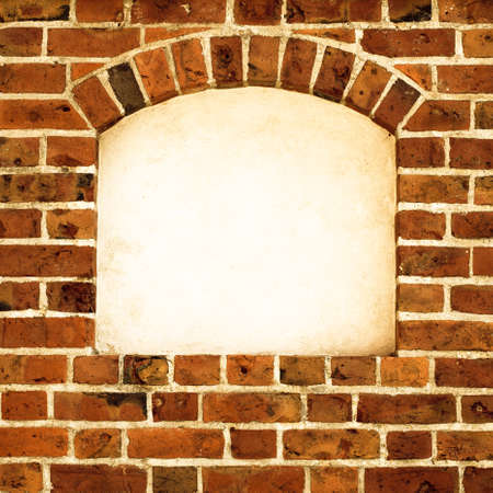 Old stone arch arc niche with space for text frame in brick wall background Stock Photo - 25704843