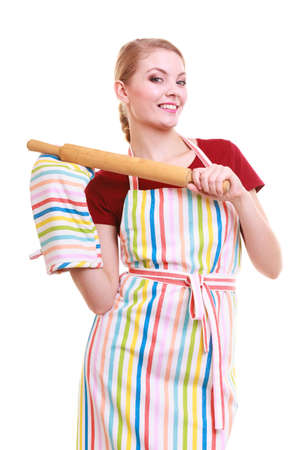 Happy housewife or baker chef wearing kitchen apron oven mitten holds baking rolling pin studio picture isolated on white photo