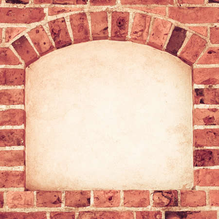 Old stone arch arc niche with space for text frame in brick wall background Stock Photo - 25841396
