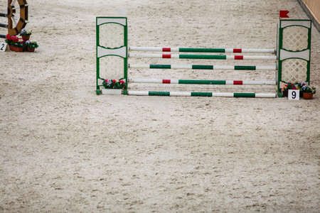 equitation: Equitation  Green red white obstacle for jumping horses  Riding competition  Real  Stock Photo