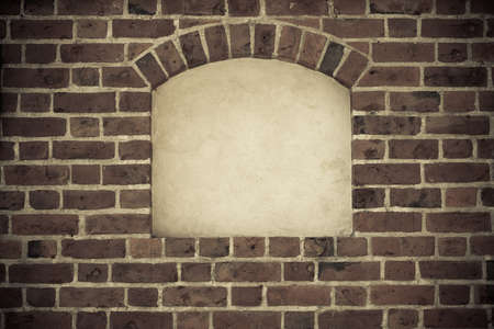 Old stone arch arc niche with space for text frame in brick wall background Stock Photo - 25926595