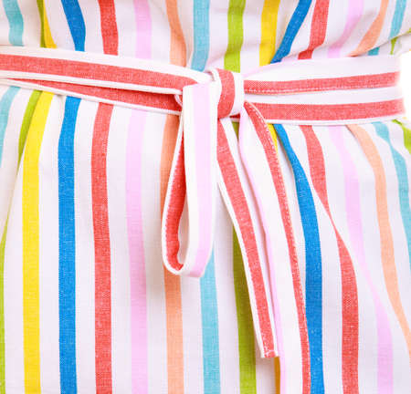 Part closeup of colorful striped kitchen apron as background   photo